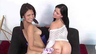 Two girls are doing girl on girl action on the sofa before us