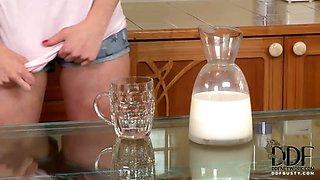 Babe Rubs Her Titties In Milk