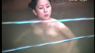 Spy cam caught all nude pale Japanese brunette bathing outdoors