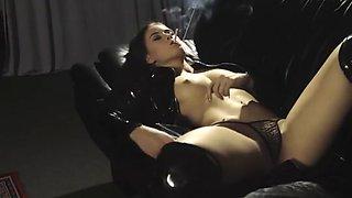 Cruel Anette smokes a cigarette while she masturbates