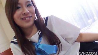 Nakoto Kurasaki  in a schoolgirl uniform licks and sucks a