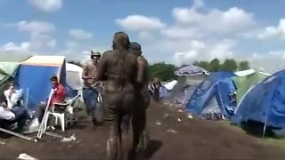 Chubby babes enjoy wrestling each other in the mud