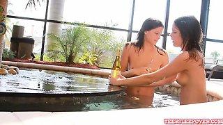 Beautiful tall lesbian twin girls swimming in the pool and