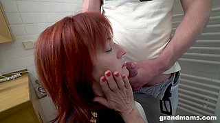 Kinky MILF fucks a random guy with a strap-on in the toilet room