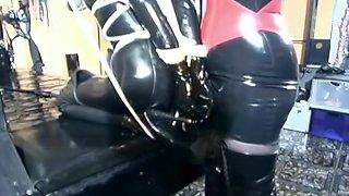 Latex Slave Tied Up In Bondage