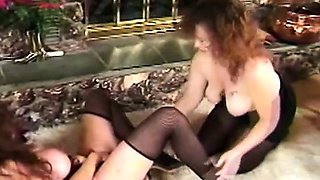 Two big breasted cougars in stockings explore their lesbian fantasies