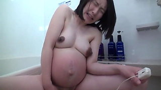 Pregnant Japanese woman with big nipples masturbates
