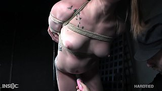 Seductive girl Cora Moth is suspended upside down and punished with a long stick