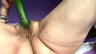 Slutty  old granny love fucking her hairy pussy with cumcumber