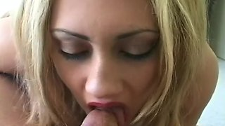 Blonde is sucking a dick and smoking a cigarette