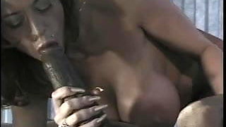 Sexy brunette gets her big tits and mouth fucked by a big black cock