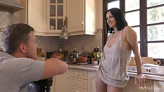 Kinky wife Cassie gives her horny lover a striptease in the kitchen
