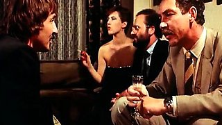 Guests in an intimate retro party watch fuck show