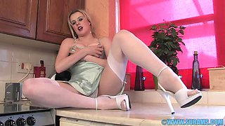 Solo hottie Syren Sexton loves fingering her pussy in the kitchen