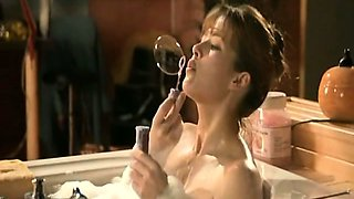 Sophie Marceau stripping down to her panties before