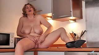 Solo video of busty mature Camilla Creampie playing in the kitchen