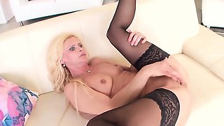 Mature blond milf enjoys a thick black cock in front of her
