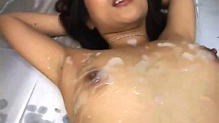 Charming Asian babe takes a heavy cumload on her cute face