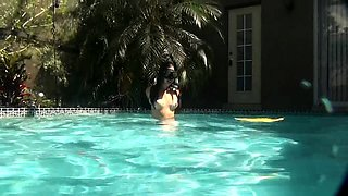 Kinky young babe satisfies her lust for bondage in the pool