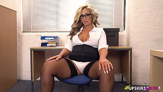 Bodacious secretary in stockings Kellie OBrian shows off her butt upskirt