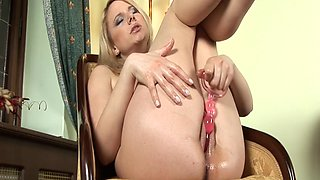 Blonde slut sticks a hard toy in her fuckin' wet cunt
