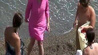 Group of nudist women in the beach