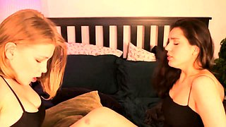 Two alluring babes enjoy a steamy lesbian romance on webcam