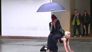 Petite blonde disgraced on the rain