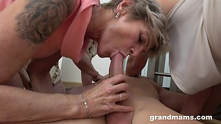Lucky dude is treated with awesome blowjob by three mature whores