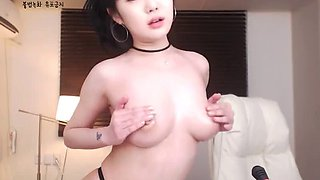 Sexy Korean babe in pantyhose shows her tits