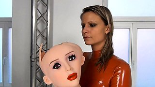 Sexy blonde milf in red latex fucks a toy and a dick