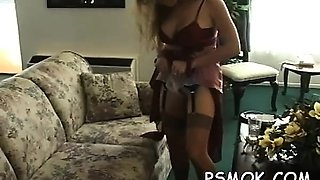 Older slut blows a guy while smoking a cigarette