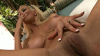 This sexy busty MILF loves being watched and she loves smoking