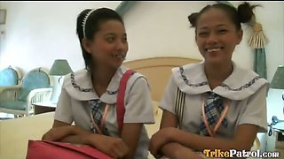 Two wild young Filipina schoolgirls in hot threesome with