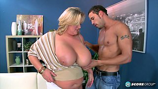 Blonde BBW with gigantic milk cans gets drilled by a stud