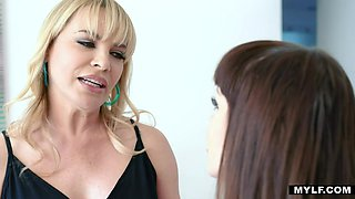 Stepmom strapon fucks stepdaughter while husband is on a business strip