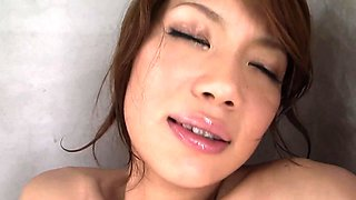 Cute Asian girl fingers her hairy pussy in the bathtub
