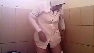Arab woman goes pee in a public toilet