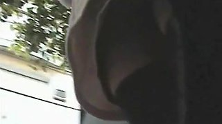 Bare pussy exposed in this upskirt voyeur cam video