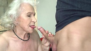 Young buddy satisfies on couch good-looking Euro granny