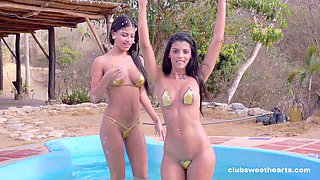 Lovely Denisse Gomez posing with gorgeous Catalina in the pool